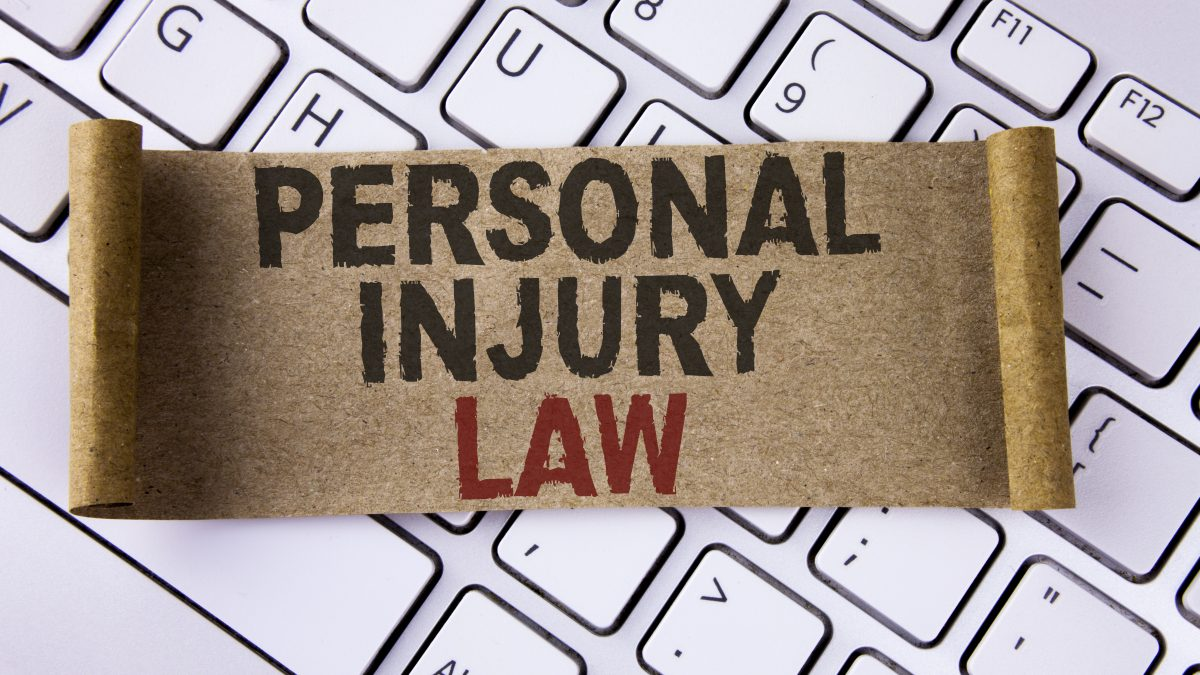 Conceptual hand writing showing Personal Injury Law. Business photo showcasing guarantee your rights in case of hazards or risks written Folded Cardboard Paper Piece placed Keyboard.